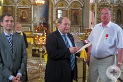 Знак ордена Святой Анны возложен на Заслуженный юриста В.И.Коростелева
