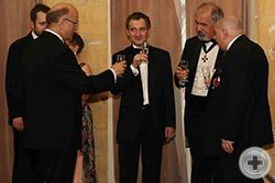 Бокал шампанского в честь юбиляра. Слева с бокалом граф Андрей Дмитриевич Толстой-Милославский